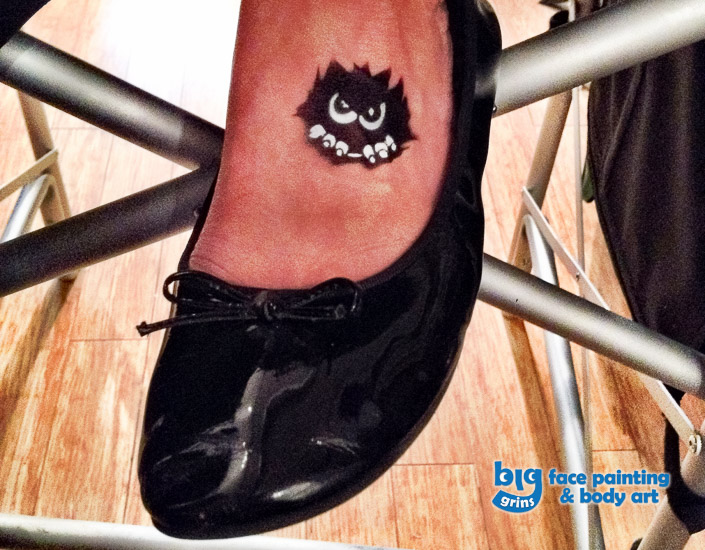 Big Grins Airbrush Temporary Tattoo of Little Monster for Grand Opening Celebration