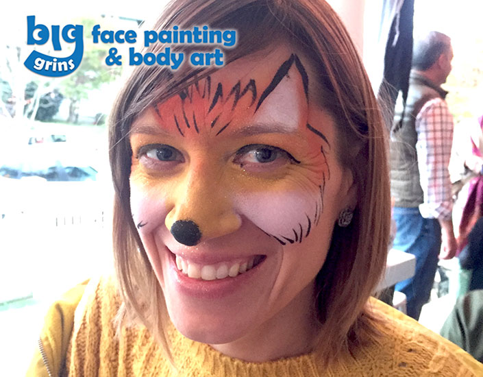 fox face painted on woman for Halloween