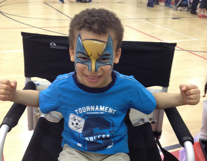 kid face painted as a super hero